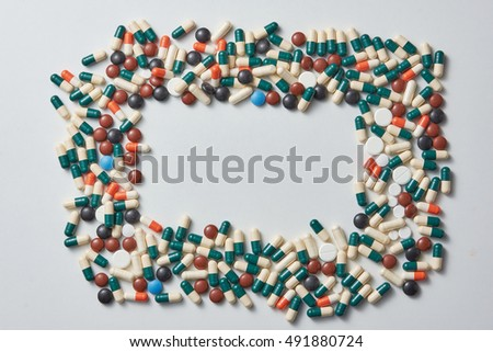 frame made of different colored pills