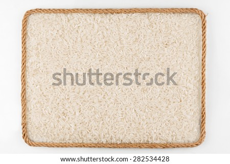 Frame made of rope with rice grains  lying on a white background, with place for your text, graphics - stock photo