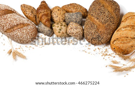 Frame of bakery product assortment with bread loaves, buns, rolls and croissants decorated with grains of sunflower, oat, flax, wheat and poppy isolated on white background.