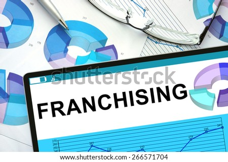 Franchising on tablet with graphs. Business concept.                 - stock photo