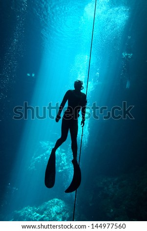 Freediver in the cenote - stock photo