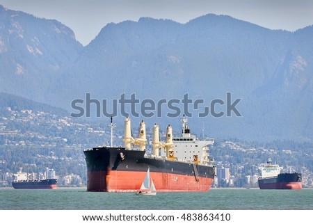 Freighters and Sailboats, Vancouver. English Bay at work and play. Vancouver, British Columbia, Canada.