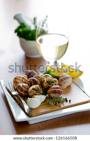 ... - Escargots de Bourgogne (snails with herbs butter) - stock photo