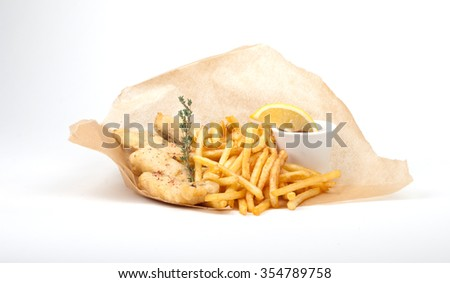 french fries and fish chips in paper on white background - stock photo