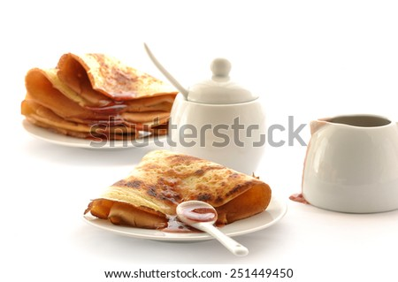 Fresh fried pancake with raspberry jam isolate in white background - stock photo