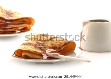 Fresh fried pancake with raspberry syrup - stock photo