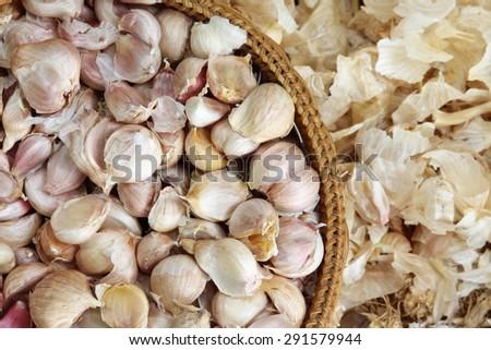 Fresh Garlic Cloves Bulb in bamboo basket - stock photo