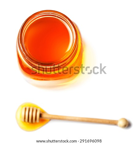 Fresh honey with a honey dipper isolated on white background, macro.  - stock photo