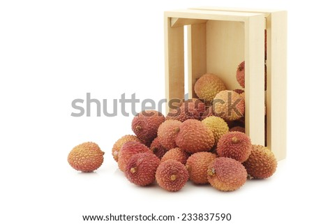 fresh lychees in a wooden box on a white background - stock photo