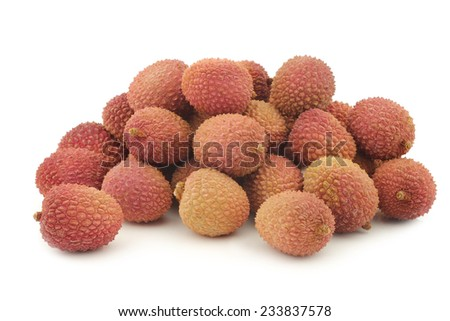 fresh lychees on a white background - stock photo