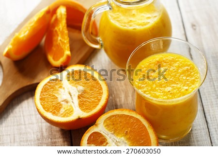 fresh orange smoothie in glasses-juice - stock photo