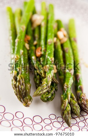 Fresh Organic Asparagus Cooked with Oil and Garlic - stock photo