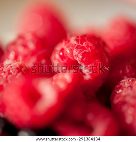 Fresh raspberries closeup. Healthy eating. Selective focus. - stock photo