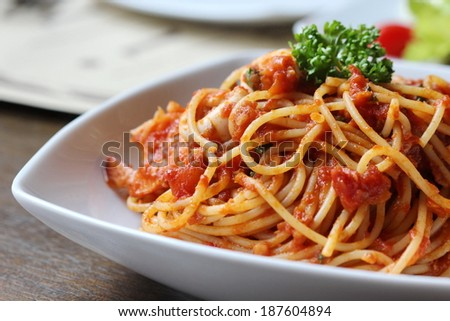 Fresh spaghetti with tomato sauce close up  - stock photo