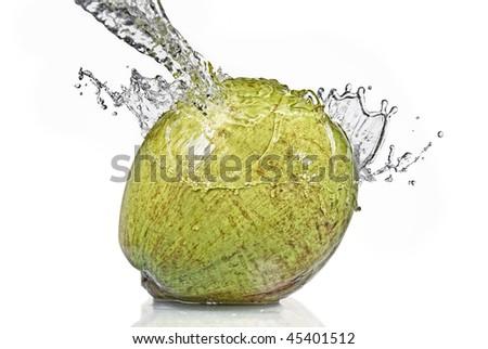 ?fresh water splash on coconut isolated on white - stock photo