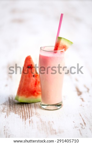 fresh watermelon smoothie garnished with watermelon slice - stock photo