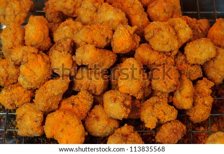 fried chicken nuggets in fresh market - stock photo