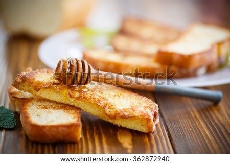 fried in batter toast with honey - stock photo