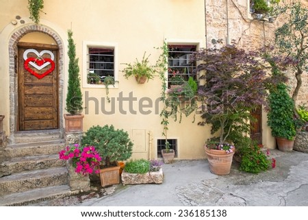Front door of a beautiful and old villa in Tuscany - stock photo