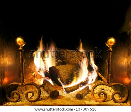 frontal image of fireplace and wood burning - stock photo