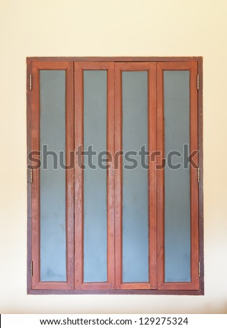 frosted glass window with wooden frame - stock photo