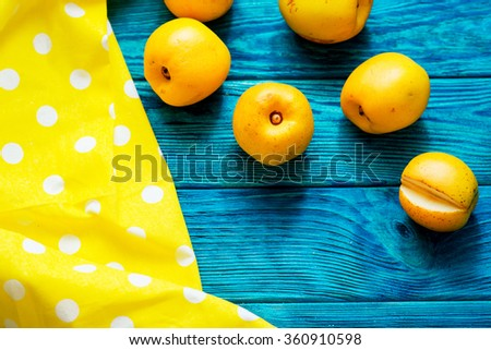 fruit, fresh ripe yellow quince on a contrasting wooden background
