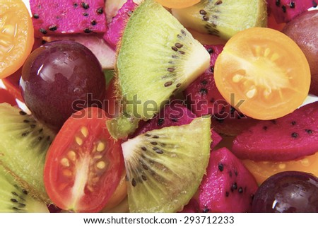 fruit salad with strawberries, oranges, kiwi, blueberries