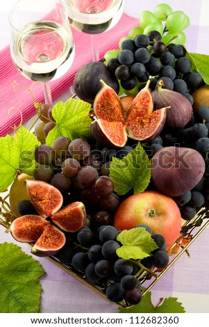 Fruit still life/ white  wine glasses /   red wine grapes