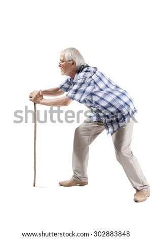 Full length portrait of a senior man walking with cane isolated on white background - stock photo