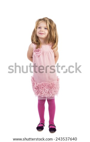 Full length portrait of an adorable little girl holding hands at back isolated over white background - stock photo