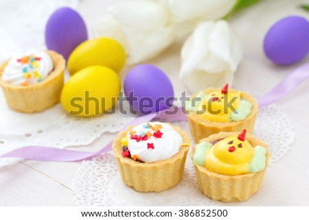Funny cupcakes with chickens and Easter eggs