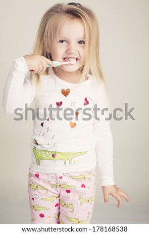 funny little girl  with tooth brush