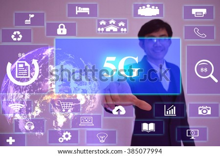 5G  concept  presented by  businessman touching on  virtual  screen ,image element furnished by NASA - stock photo