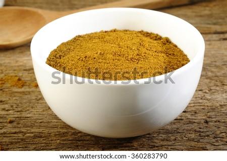 garam masala powder in white bowl - stock photo