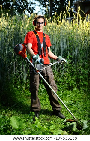 Gardener with lawn mower, - stock photo