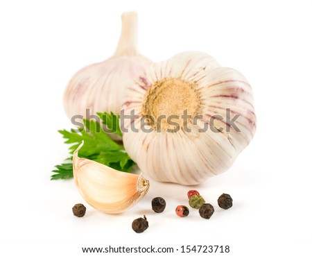 garlic with a piece of parsley isolated on white close-up - stock photo