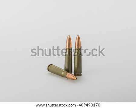 7,62 Ã? 39 gauge riffle shells used for hunting on gray gradient background - stock photo
