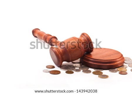 Gavel and coin on a white background - stock photo