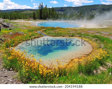 Gem pool and pinto spring in the cascade geyser  group in yellowstone  national park, wyoming - stock photo