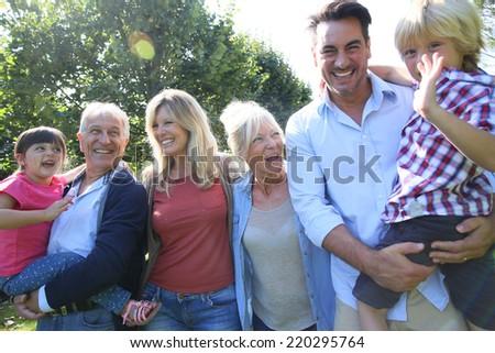 3-generation-family enjoying time together - stock photo