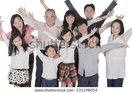 3 generation family raise hands
