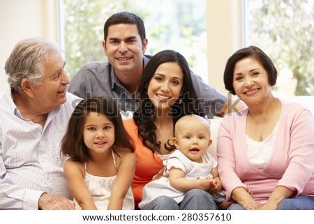3 generation Hispanic family at home - stock photo