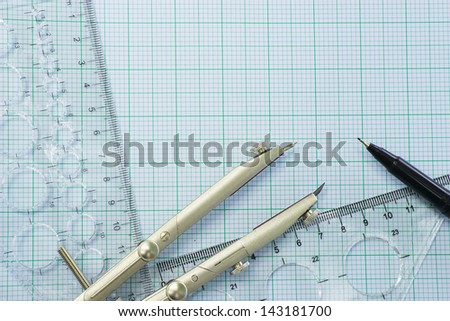 Geometry set with pen on graph paper,space for text - stock photo