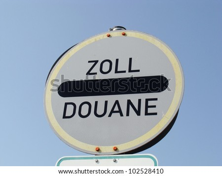 German sign which says the german word Zoll (=customs) and the french word Douane (=customs) - stock photo
