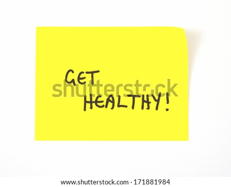 'Get Healthy' written on a yellow sticky note - stock photo