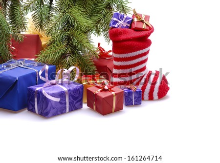 gift boxes  with stocking  under  Christmas tree  - stock photo