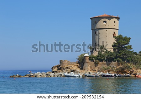 GIGLIO ISLAND, ITALY - JULY 19, 2014: Landscape of Torre del Campese, in a beautiful bay on the island. People relax on the beach or in the sea on a hot July day, In Giglio Island, Tuscany - Italy