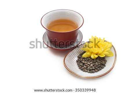Ginseng  twisted tea leaves with yellow flower and gaiwan full of green tea
