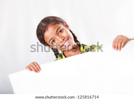 girl demonstrating a poster - stock photo
