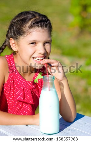 girl drinking milk from bottle  - stock photo